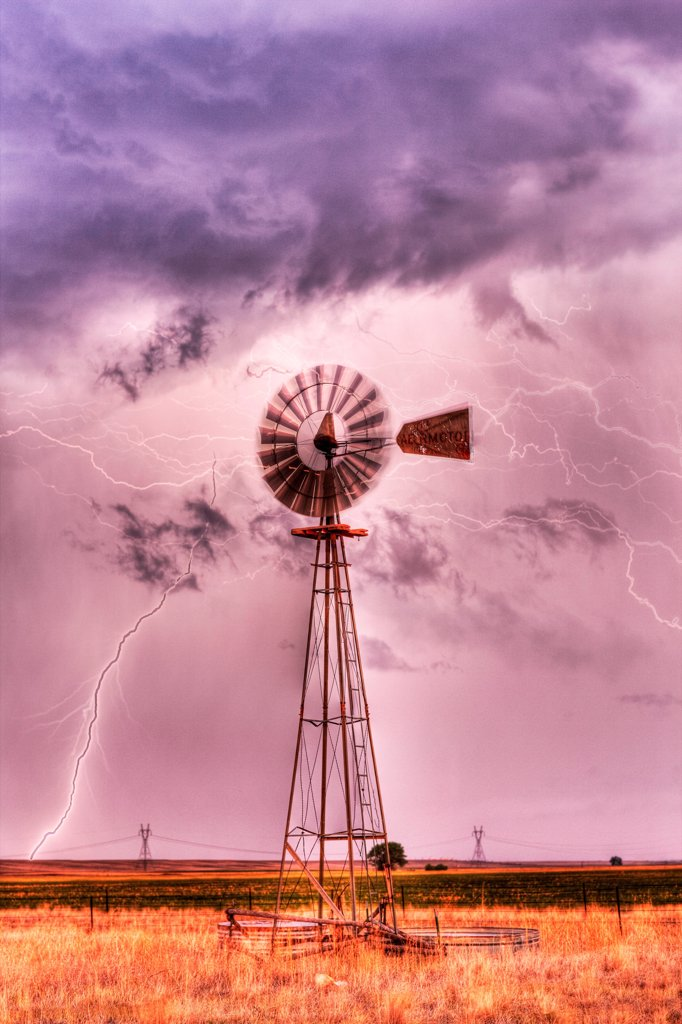 Stock Photo: 4316-4564 Lightning and lone windmill, eastern plains of Colorado, USA