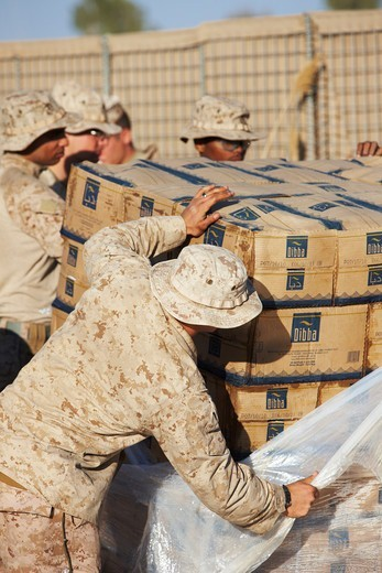 Stock Photo: 4316-4675 United States Marines unload boxes of bottled water at a remote, austere forward operating base in Afghanistan's Helmand Province
