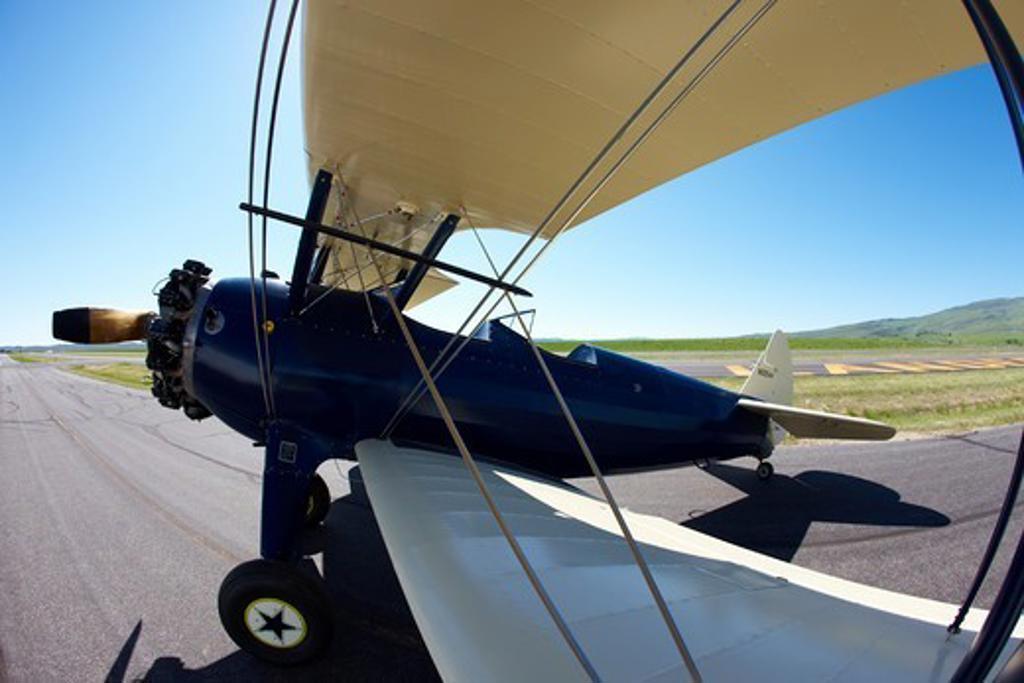 Stock Photo: 4316-4832 Boeing-Stearman Model 75 Biplane on runway, Lander, Wyoming