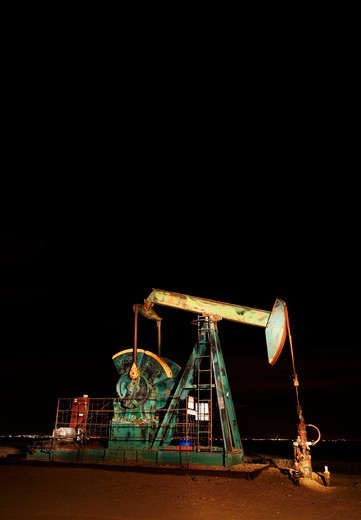 Oil well pumpjack at night : Stock Photo