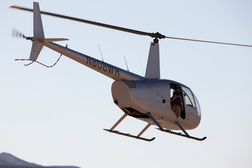 Robinson R44 Helicopter in California desert : Stock Photo