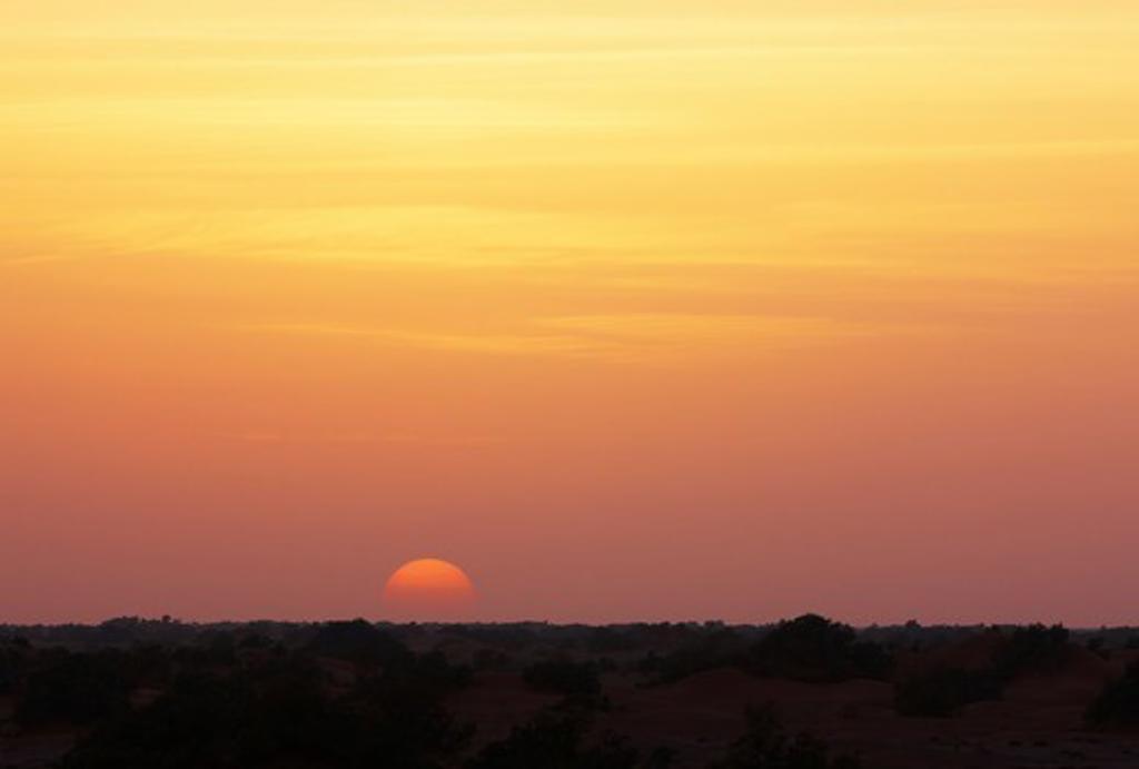 Stock Photo: 4316-5140 View of setting sun through Harmattan Haze, interior Sahara Desert, Morocco