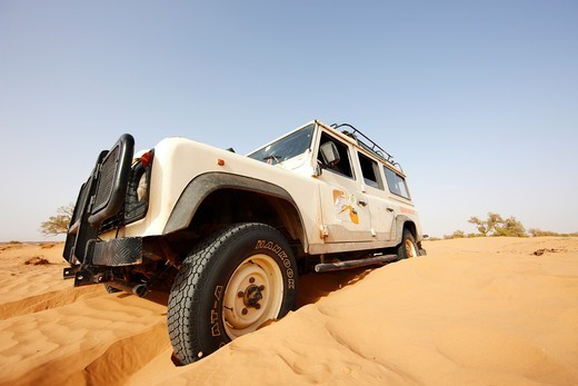 Stock Photo: 4316-5150 Digging out a Land Rover stuck in sand, Erg Chegaga, interior Sahara Desert, Morocco