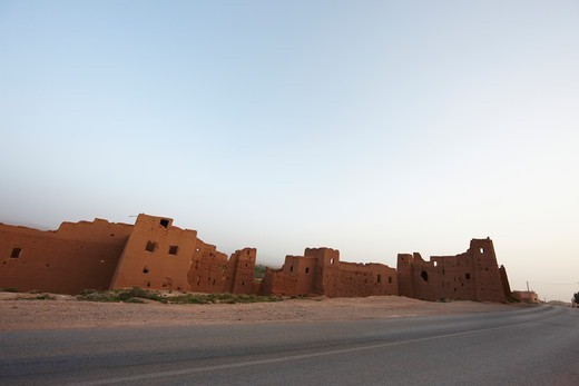 Stock Photo: 4316-5162 Ruins of earthen dwellings, modern paved road, Morocco