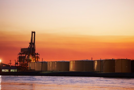 Stock Photo: 4316-5427 Large oil tanks and a container loader in distance, Mobile River, Mobile, Alabama, USA