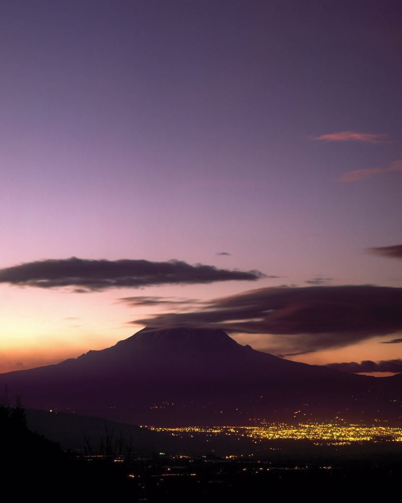 Stock Photo: 4316-543 The City Lights of Riobamba Come Alive in the Shadow of Chimborazo
