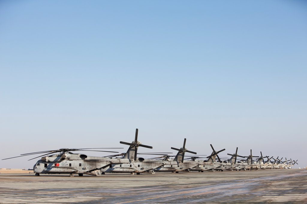 Line of United States Marine Corps CH-53E Super Stallion heavy lift cargo helicopters, Camp Bastion, Helmand Province, Afghanistan : Stock Photo