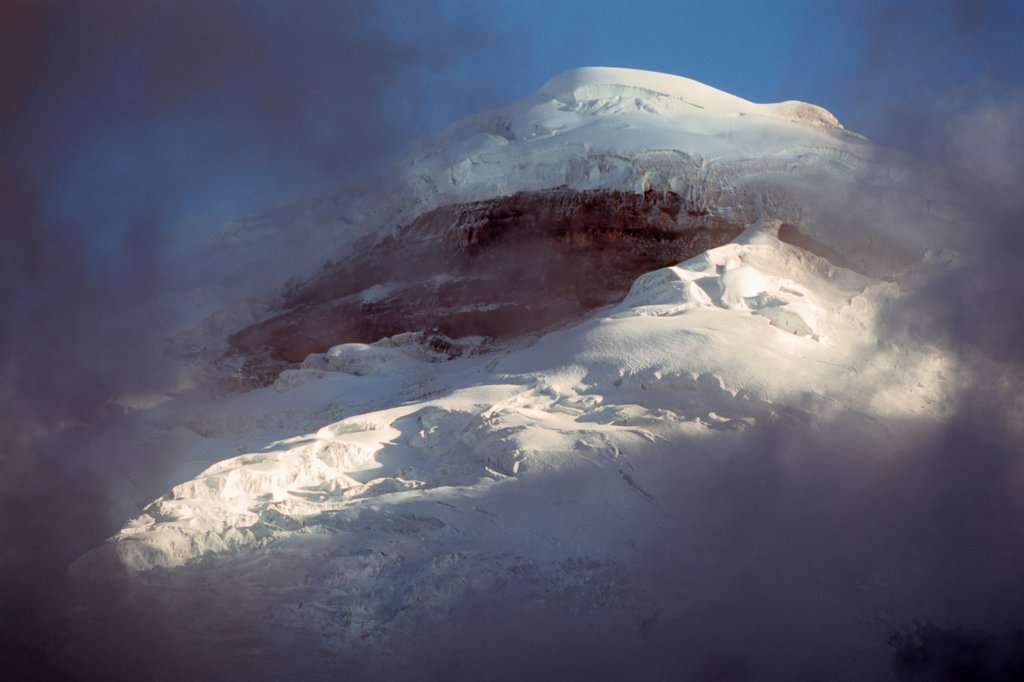 Stock Photo: 4316-576 Breaking Clouds Reveal Cotopaxi's Jumbled, Heavily Glaciated Summit