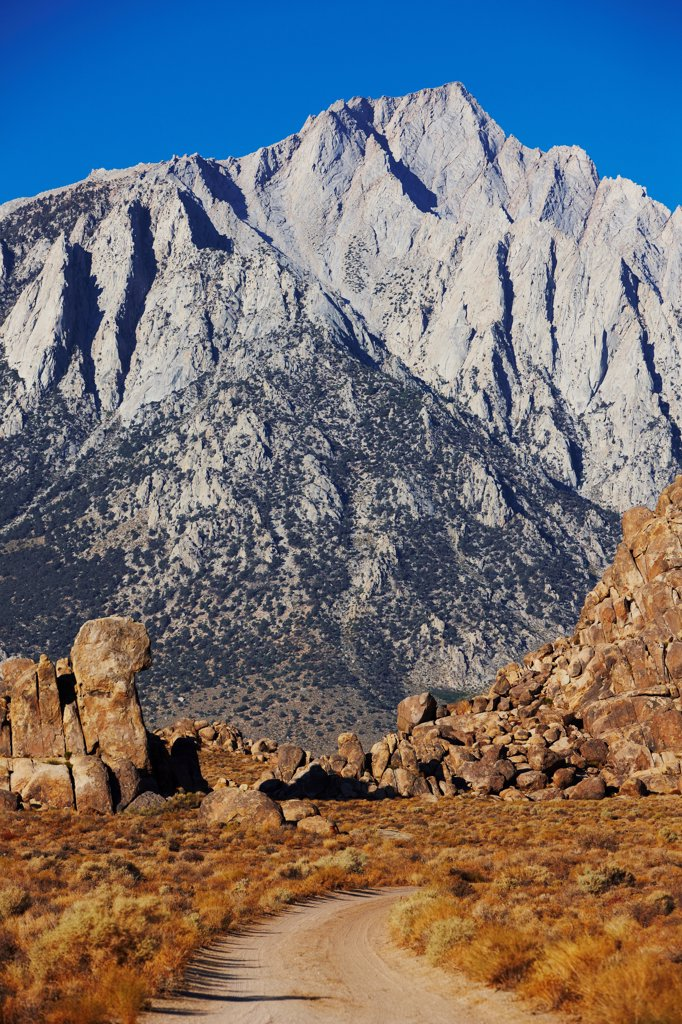 Stock Photo: 4316-5770 USA, California, Dirt road through Alabama Hills, under Mount Lone Pine, near Lone Pine