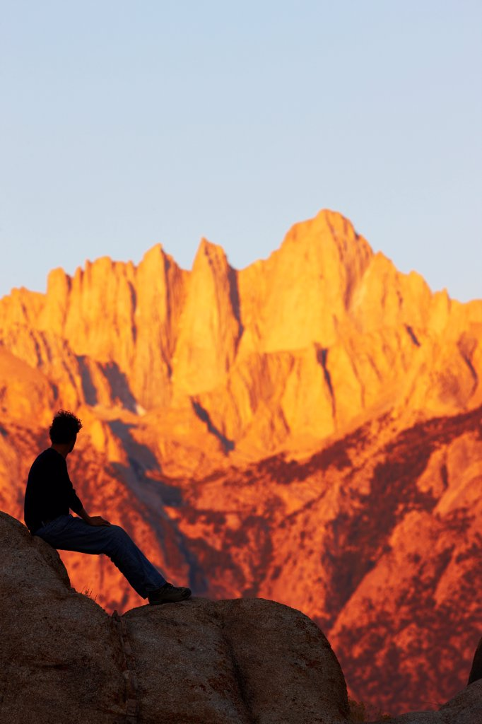 Stock Photo: 4316-5776 USA, California, Man gazing at Mount Whitney from Alabama Hills at dawn light