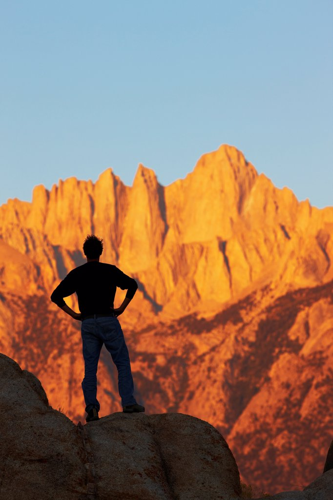 Stock Photo: 4316-5777 USA, California, Man gazing at Mount Whitney from Alabama Hills at dawn light