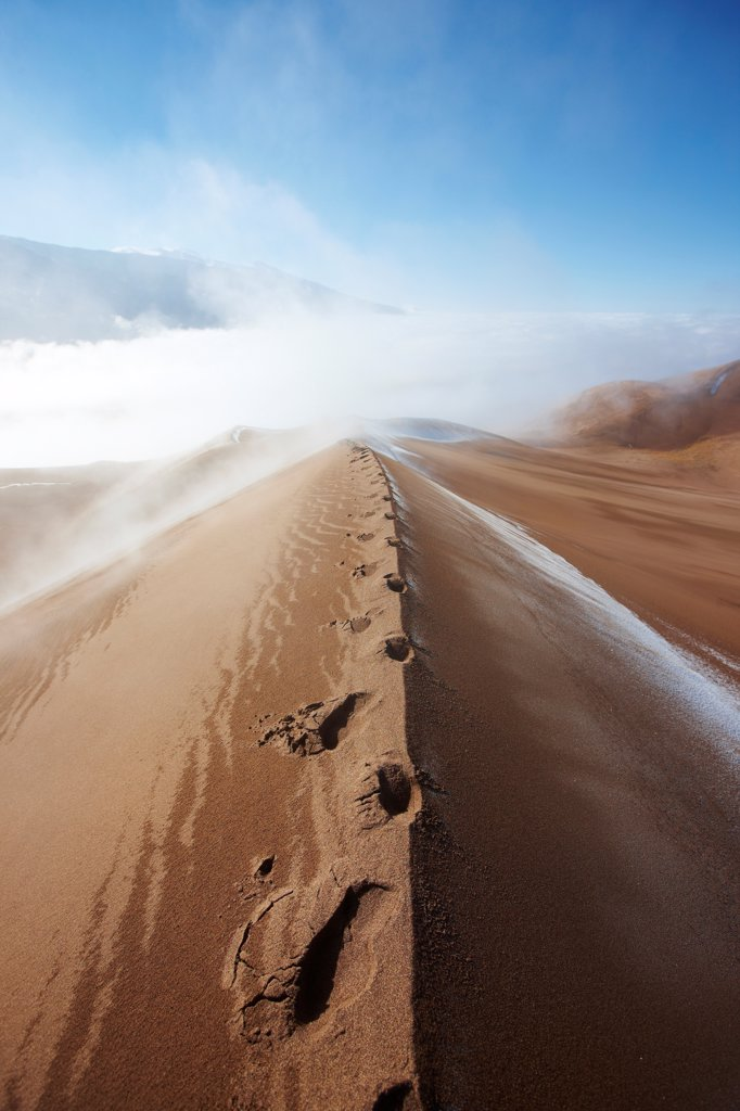 Stock Photo: 4316-5863 USA, Colorado, San Luis Valley, Footsteps on crest of sand dune after snow storm at Great Sand Dunes National Park
