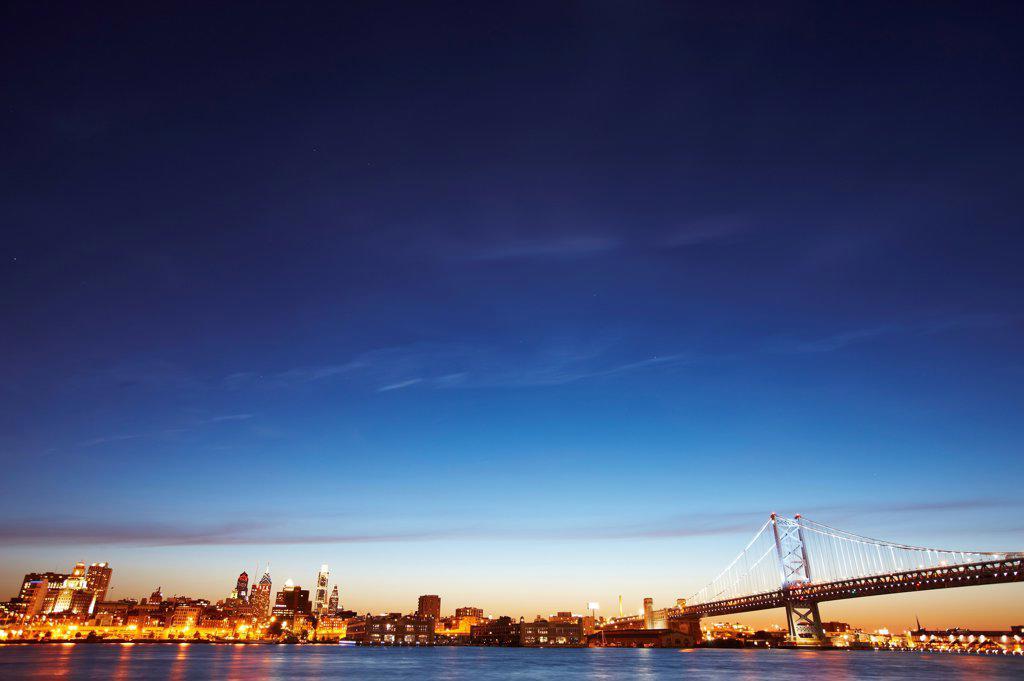Stock Photo: 4316-5955 USA, Pennsylvania, Philadelphia, Wide angle view of Philadelphia, Pennsylvania skyline and Benjamin Franklin Bridge over Delaware River