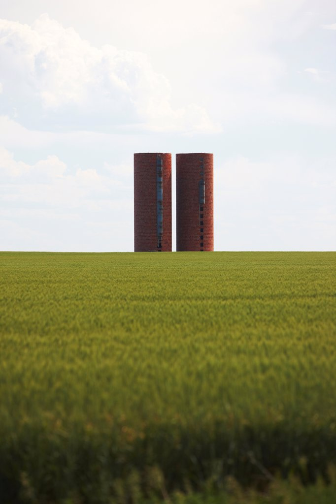 Stock Photo: 4316-5989 USA, Kansas, Grain silos on wheat field