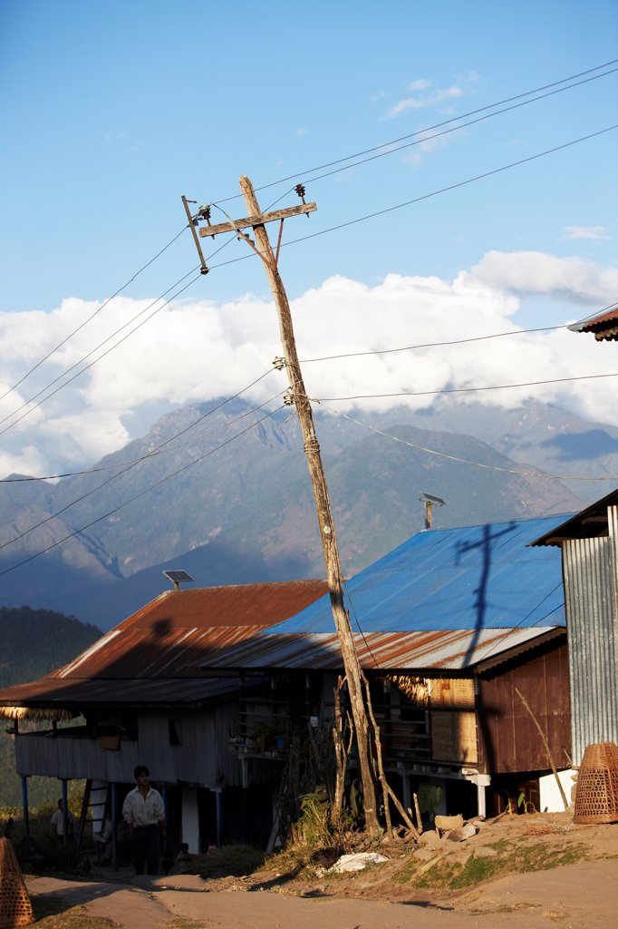 Stock Photo: 4316-6199 Nepal, Num Village, Leaning power and telephone line pole