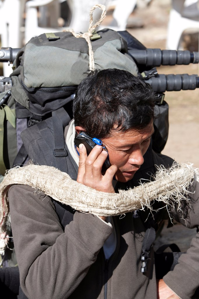Stock Photo: 4316-6246 Nepal, Khumbu Region, Himalaya, close-up of Nepalese Sherpa porter talking on mobile phone