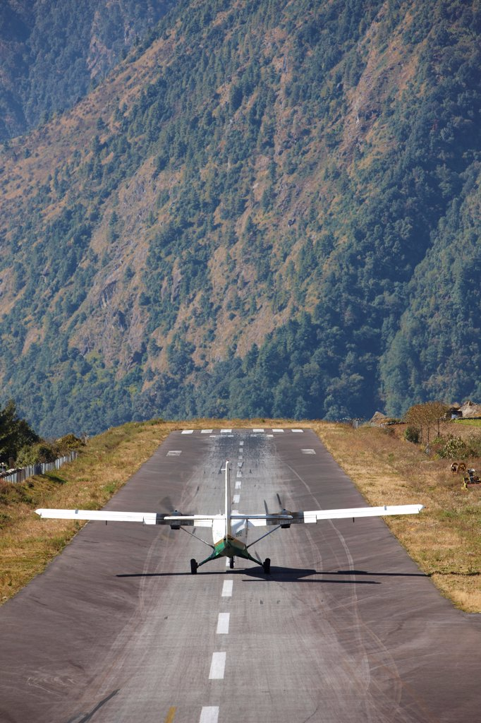 Nepal, Khumbu Region, Lukla, Tenzing-Hillary Airport, twin-turboprop aircraft taking off, rear view : Stock Photo