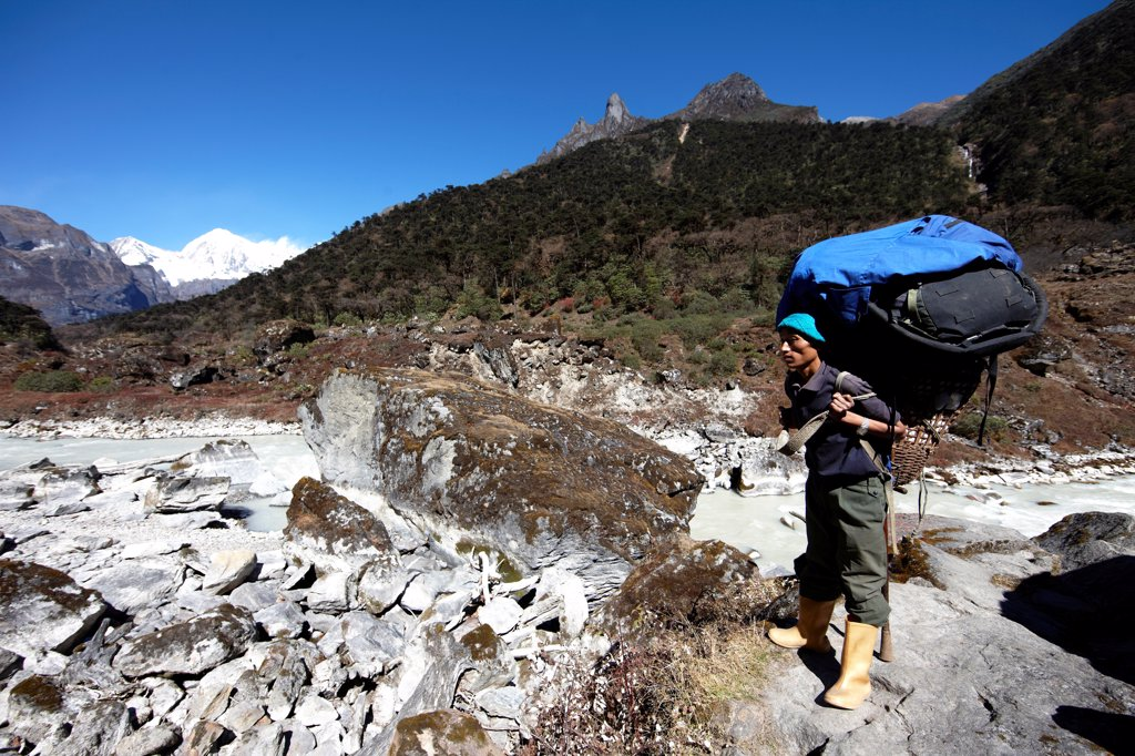 Stock Photo: 4316-6405 Nepal, Himalaya, Makalu-Barun National Park, Sherpa porter carrying load on his back