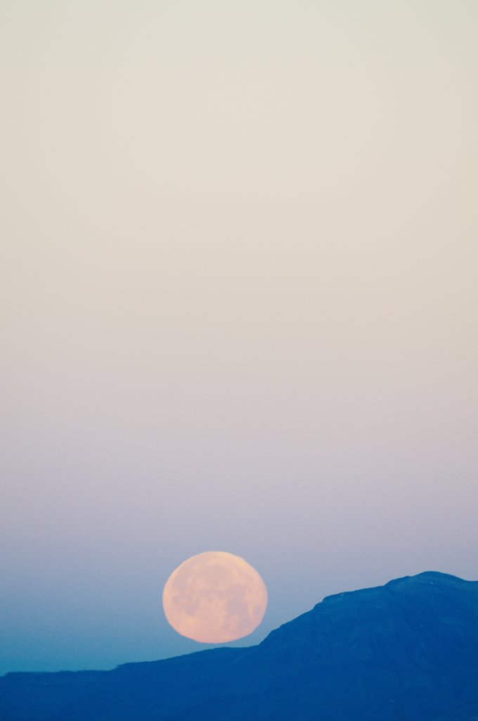 Stock Photo: 4316-6546 Rising full moon on mountain ridge, Tularosa Basin, Alamogordo, New Mexico, USA
