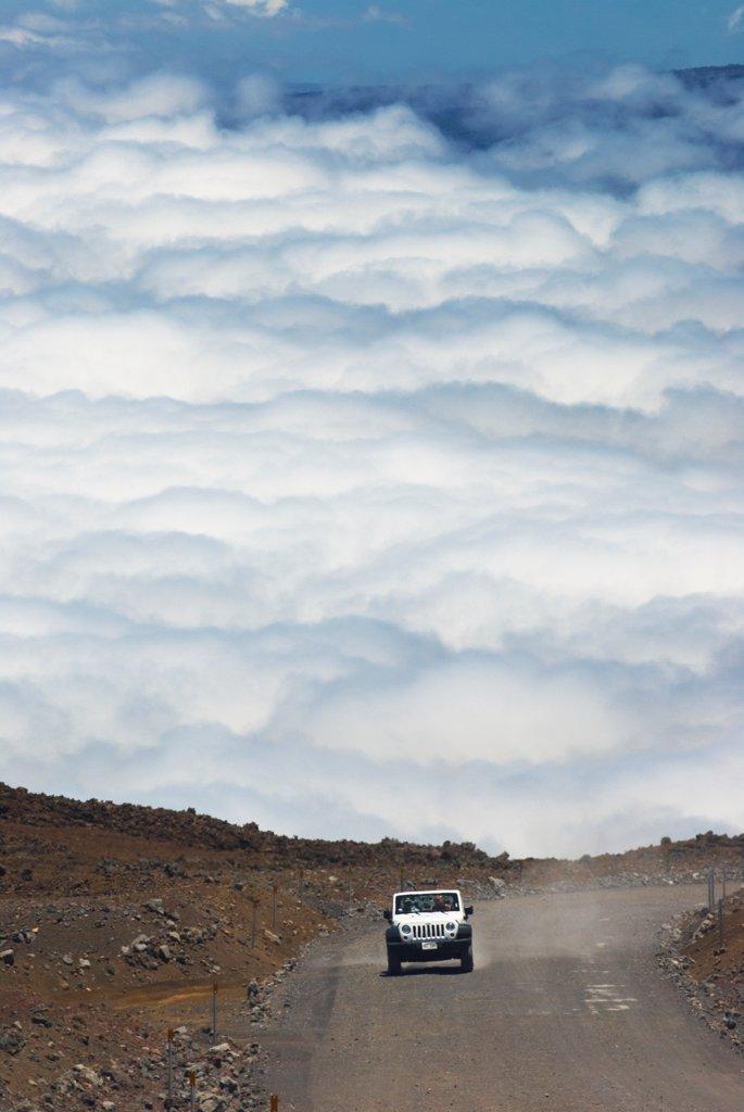 Stock Photo: 4316-6634 Jeep ascends the unpaved section of the John A. Burns Way near the summit of Mauna Kea, Hawaii County, Hawaii, USA
