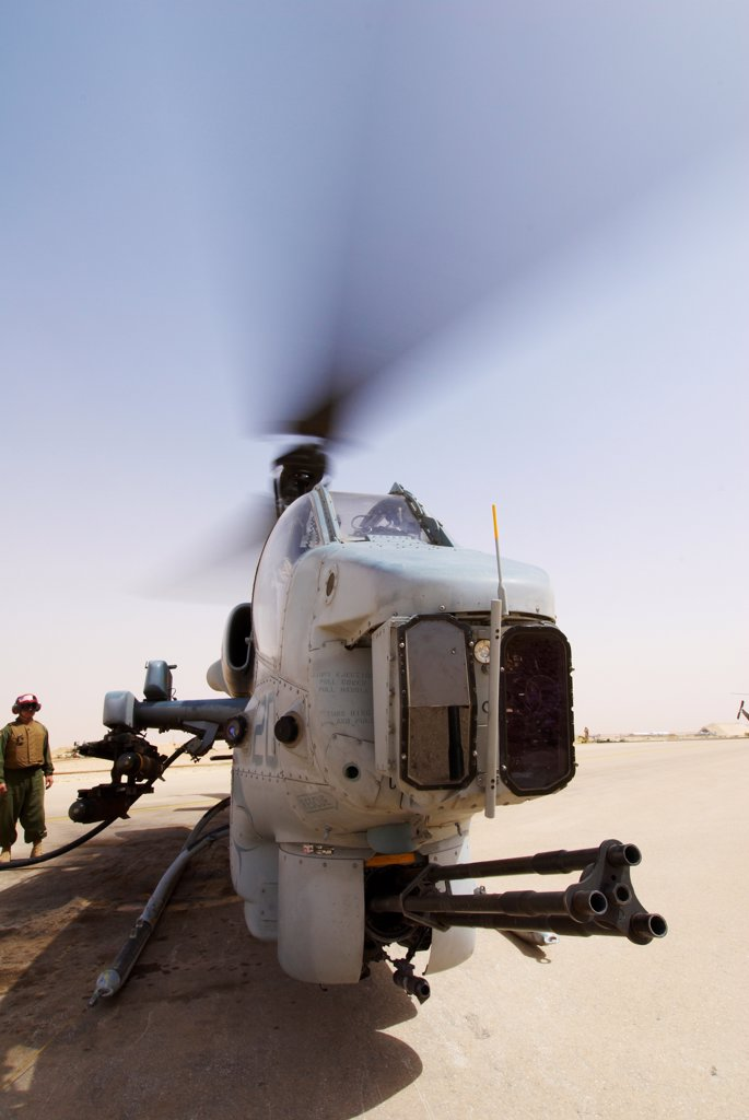 Stock Photo: 4316-6676 US Marine Corps AH-1W SuperCobra attack helicopter being refueled at Al Asad Air Base, Iraq