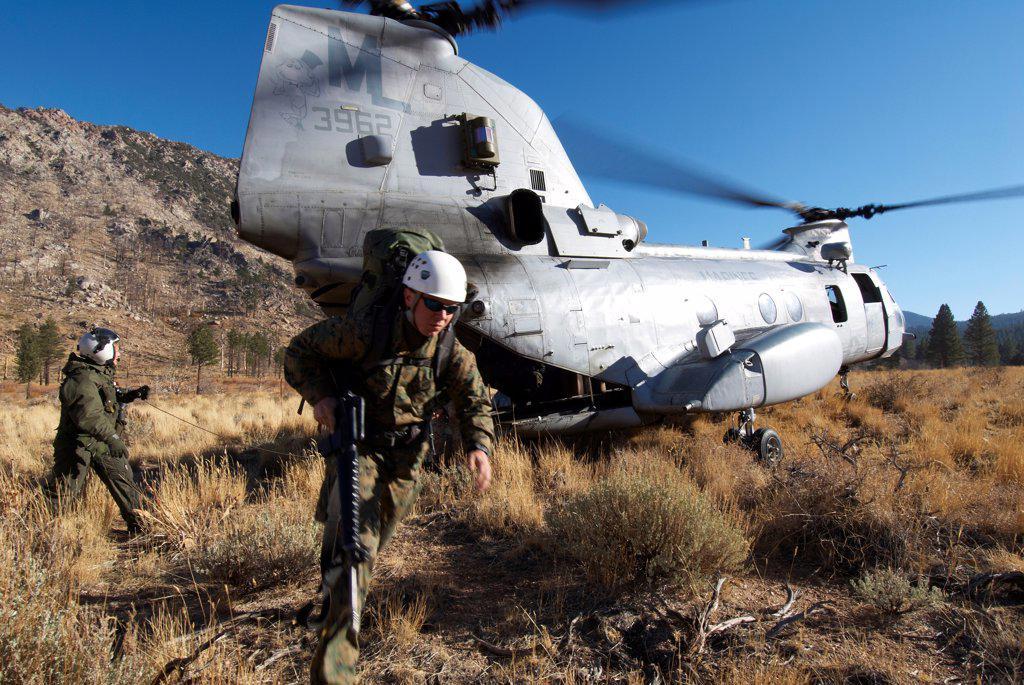 Stock Photo: 4316-6774 US Marine Corps CH-46 Sea Knight lands at a high altitude and unloads US Marines for mountain warfare training at Marine Corps Mountain Warfare Training Center, Bridgeport, California, USA