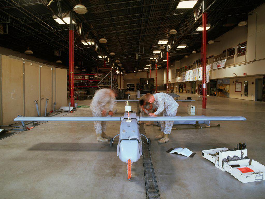 Stock Photo: 4316-883 US Marine Technicians Prepare a Pioneer UAV for a Mission