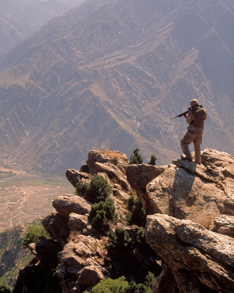 Stock Photo: 4316-932 A US Marine Scans the Mountainous Distance Through the Sight of His M-16