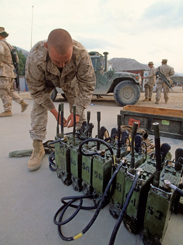 A US Marine Prepares Radios for an Upcoming Combat Operation in Afghanistan's Eastern Kunar Province : Stock Photo