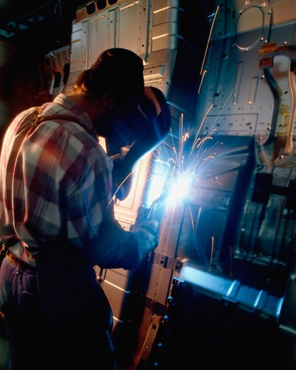 Welder Performs Spot Welding on a Truck : Stock Photo