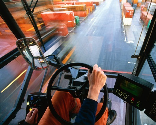 Stock Photo: 4325-229 Driving a Straddle Carrier