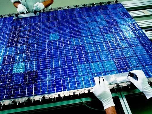 Stock Photo: 4325-637 Assembling Modules of Photovoltaic Cells