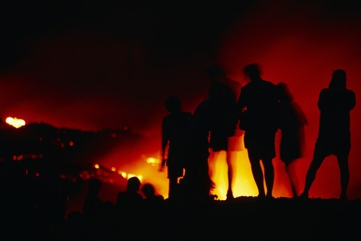 Spectators Watch Lava Flow into the Ocean at Night : Stock Photo
