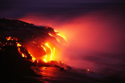 Lava Flows From Kilauea to the Ocean at Night : Stock Photo