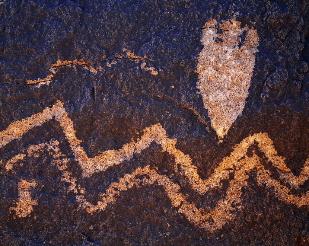 Archaic hunting-gathering petroglyphs of the Chihuahuan Desert featuring spear point design and wavy lines, Hudspeth County, Texas.  AC2 : Stock Photo