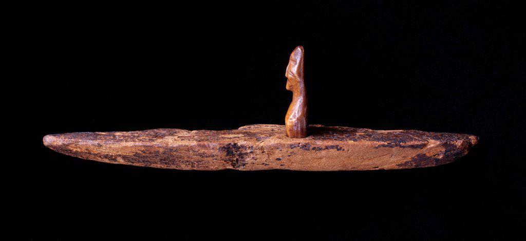Stock Photo: 4332-3322 USA, Alaska, St. Lawrence Island, Okvik ivory human figure in wooden kayak, circa 200 BC to 100 AD