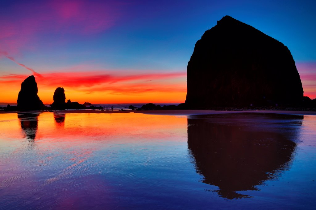 USA, Oregon, Cannon Beach, View of sunset afterglow over Haystack Rock : Stock Photo