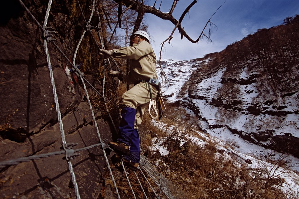Steel mesh erected over sections of Japan's Mount Fuji protects areas of the mountain that may shake loose in an eruption or earthquake. : Stock Photo