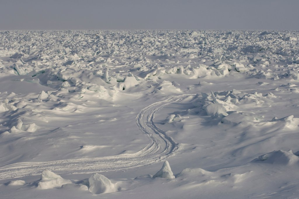 Stock Photo: 4340-1387 Snow Machine Tracks through the Pack Ice Over the Chukchi Sea