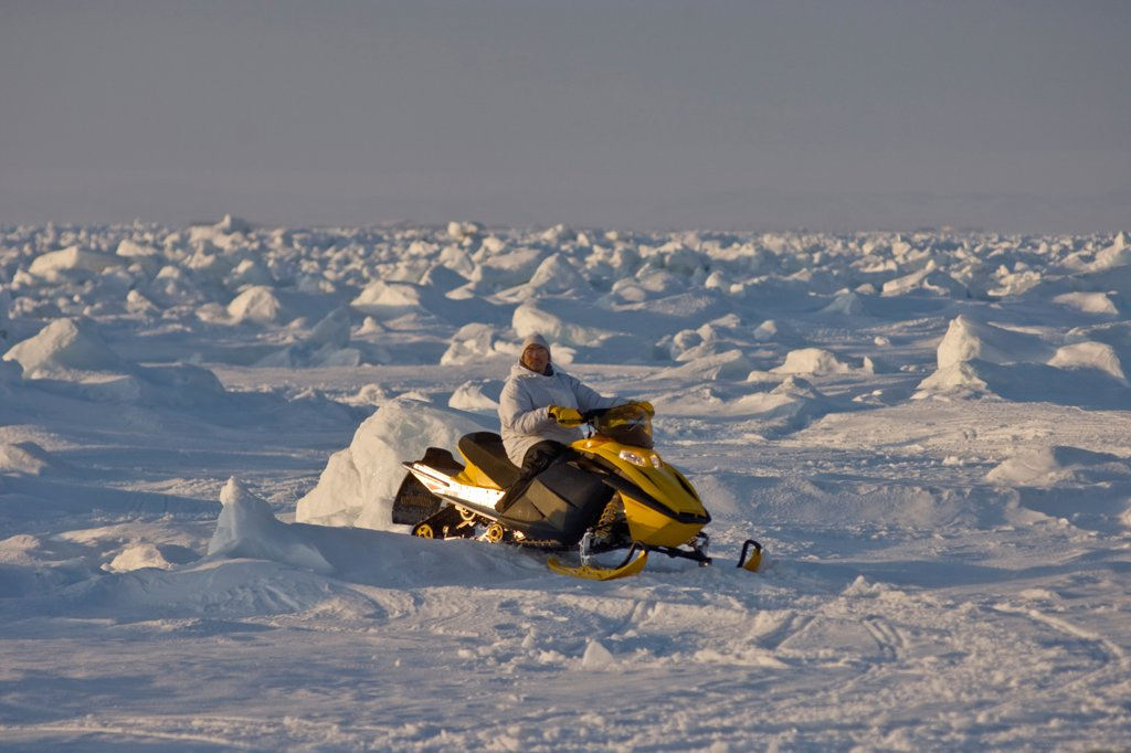 Stock Photo: 4340-1407 Inupiaq Whaler Traveling by Skidoo Over the Pack Ice, Chukchi Sea