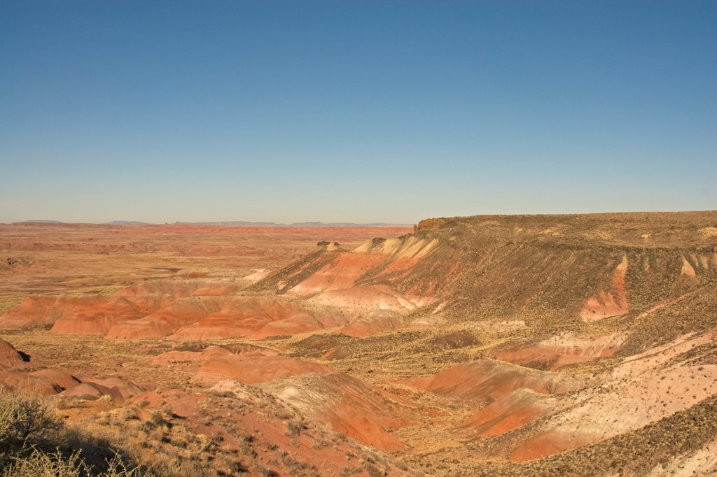 Stock Photo: 4340-1649 The multi-hued badlands of the Painted Desert include sandstone and clay, dark layers reflect high carbon content, and the reds are iron-stained siltstone, in Petrified Forest National Park, Arizona.
