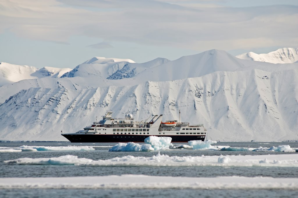 View of a luxury cruise vessel anchored in Liefdefjorden, Svalbard, Norway, in summertime. : Stock Photo