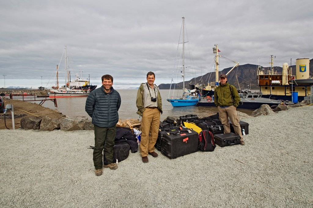 Stock Photo: 4340-2190 Three photographers arrive for a chartered sailboat expedition circumnavigating the Svalbard archipelago in summertime, Norway.