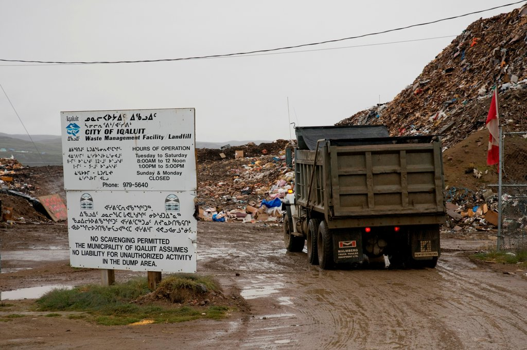 Garbage truck arrives at the local Waste Management facility in the city of Iqaluit, Nunavut Territory, Canada : Stock Photo