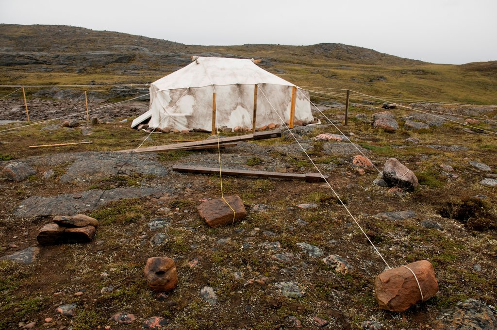 Stock Photo: 4340-2479 Scientific base camp tent secured heavily by stones due to the occassion of strong winds, Sylvia Grinnell Territorial Park, outside the capital city of Iqaluit, Baffin Island, Nunavut Territory, Canada