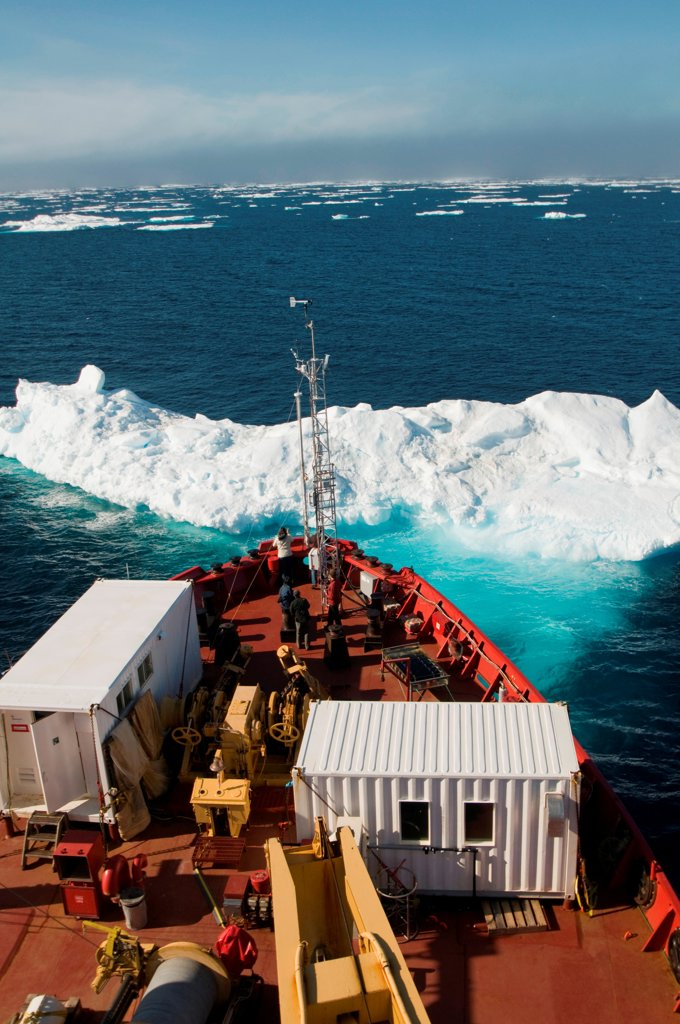 Iceberg floating off the bow of the CCGS Amundsen, a coast guard ship where scientific research is conducted, as it travels through the Northwest Passage in summer, northwest of Baffin Island, Nunavut, Canada : Stock Photo