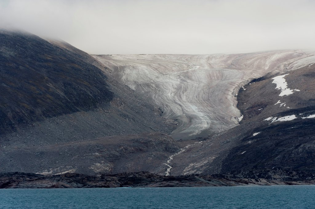 Arctic barren rocky landscape of a melting glacier on the northwest corner of Baffin Island, Northwest Passage in August, Nunavut, Canada : Stock Photo