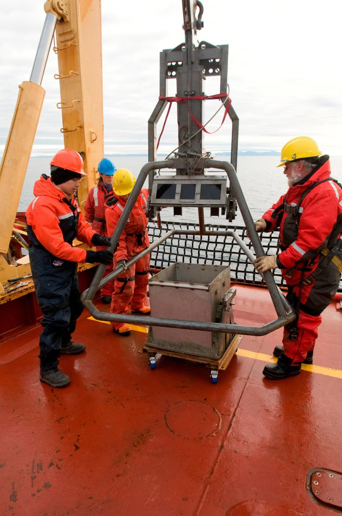 ArcticNet scientists prepare the box car, which takes sediment samples from sea floor, including benthic organisms and mud, aboard the CCGS Amundsen, Northwest Passage, Baffin Bay, Nunavut, Canada : Stock Photo