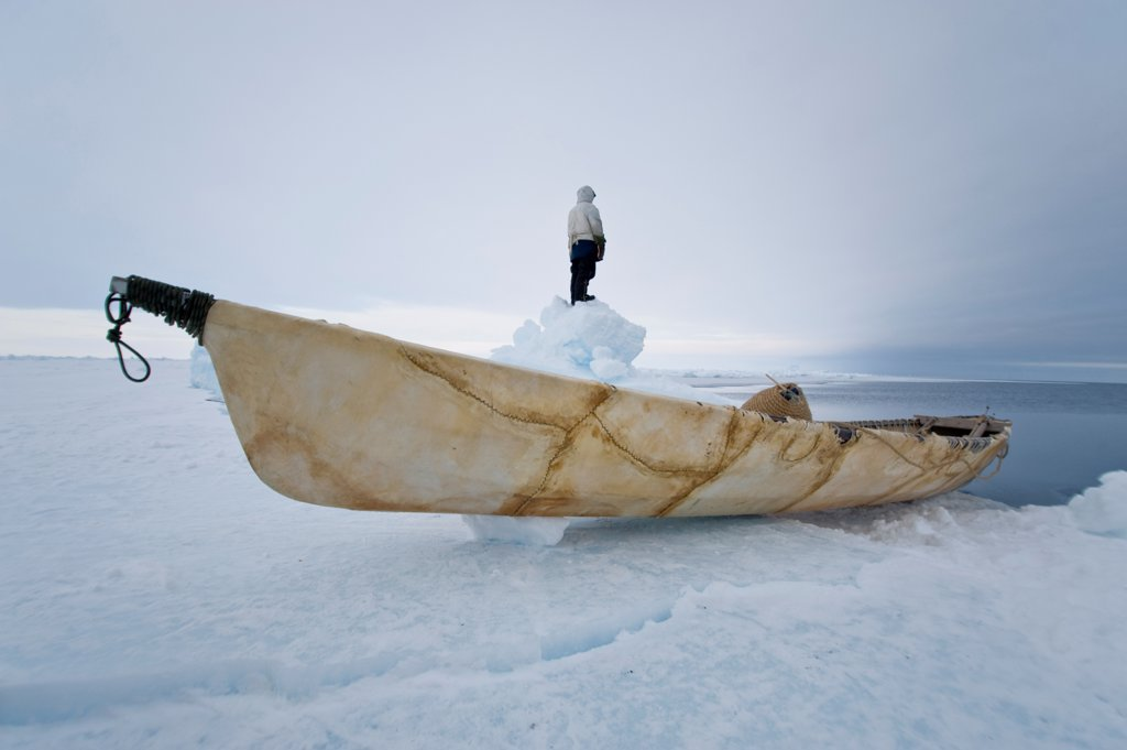USA, Alaska, Inupiaq whaler with an umiak standing on jumbled ice at edge of open lead : Stock Photo