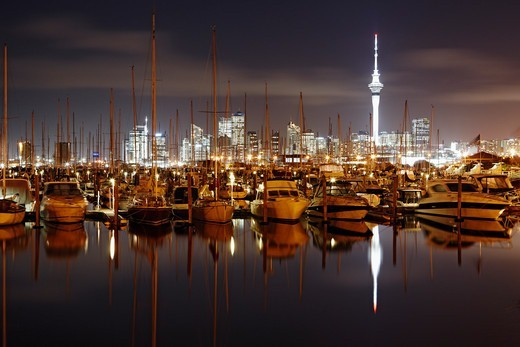 The Westhaven Marina at night time with the bright skyline of Auckland in the back. New Zealand. : Stock Photo